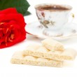 White chocolate, a cup of coffee, rose isolated on white — Stock Photo #4019154