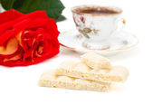 White chocolate, a cup of coffee, rose isolated on white — Stock Photo