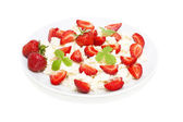 Cottage cheese with strawberries isolated on white — Stockfoto