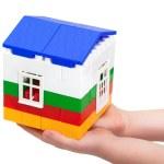 House of blocks in children's hands — Stock Photo