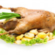 Christmas dinner goose baked with vegetables — Stock Photo
