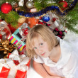 Blonde teen girl under the Christmas tree — Stock Photo