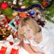 Blonde teen girl under the Christmas tree — Stock Photo #4152385