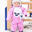 Baby girl for a walk on a winter day — Stock Photo