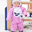 Lovely baby girl for a walk on a winter day — Stock Photo #4187290