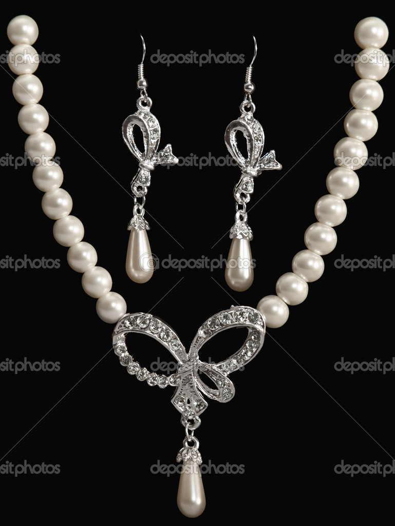 Luxury jewelry pearl set (necklace and earrings) over black background  Stock Photo #4354296