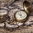 Vintage clock at antique map — Stockfoto