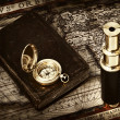 Royalty-Free Stock Photo: Vintage telescope and compass at antique map
