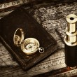 Stock Photo: Vintage telescope and compass at antique map
