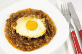 Stew with onion, meat and egg — Stock Photo