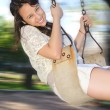 Girl on a swing — Stock Photo #4177443