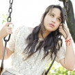 Woman sitting on a swing — Stock Photo