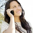 Stock Photo: Girl talking on a mobile