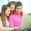 Family with laptop — Stock Photo #4177485