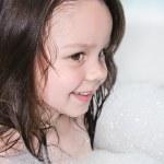 Little girl in the foam — Stock Photo