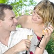 Couple celebrating with champagne — Stock Photo
