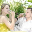 Young couple celebrating with champagne together, outdoors — Stock Photo #4417549