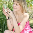 Girl drinking champagne — Stock Photo