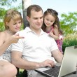Stock Photo: Family enjoy laptop