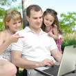 Family enjoy laptop - Stock Photo