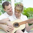 Couple with a guitar — Stock Photo