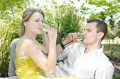 Young couple celebrating with champagne together, outdoors — Stock Photo