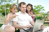 Family enjoy laptop — Stock Photo