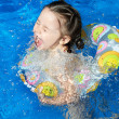 Girl playing in water — Stock Photo