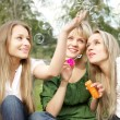 Three girls in the park — Stock Photo