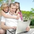Family enjoy laptop — Stock Photo