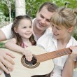 Family plaing guitar — 图库照片