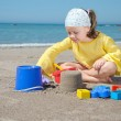 Child playing on the beach — Stock Photo