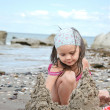 Child building sand castle — Stock Photo #5195482
