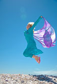 Woman jumping on the beach — Stock Photo
