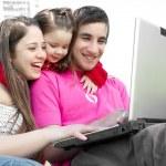 Family enjoy laptop outdoors — Stock Photo #5323134
