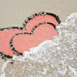 Heart drawn on wet sand - Stock Photo