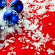 Royalty-Free Stock Photo: Blue christmas decoration on red background