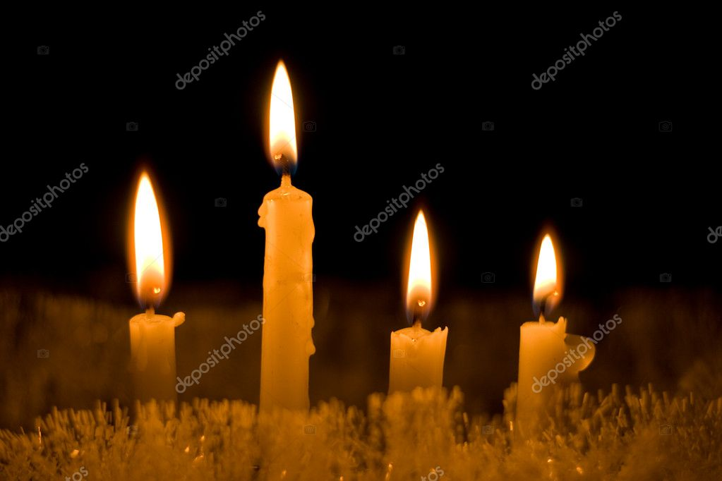 Four small  Cristmas candles on black background  Stock Photo #4182813