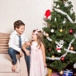 Stock Photo: Girl and boy near a fir-tree