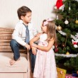 Stok fotoğraf: Girl and boy near a fir-tree