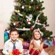 Girl and boy near a fir-tree — 图库照片 #4389526