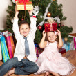 Girl and boy near a fir-tree — Stock Photo #4389527