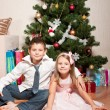 Girl and boy near a fir-tree — ストック写真