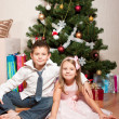 Stock fotografie: Girl and boy near a fir-tree