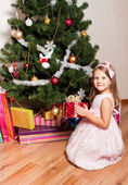 Girl with gifts near a fir-tree — Stock Photo
