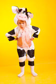 Little girl in the suit of cow — Stock Photo