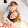 Stock Photo: Womwith son on bed