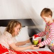 Boy brought breakfast to the mother in a bed — Stock Photo