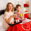 Stock Photo: Womwith her son breakfast in bed