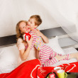 Woman with her son breakfast in a bed — Stock Photo #4891357